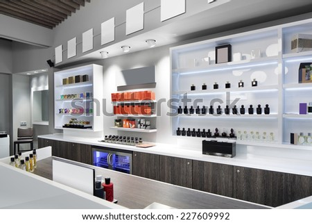 light and stylish luxury perfume store with famous fragrance - stock photo