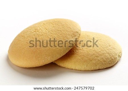 Light and sweet sponge biscuits shown up close  - stock photo
