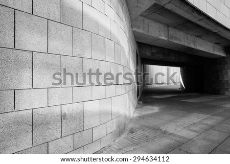 Light at the end of tunnel black and white - stock photo