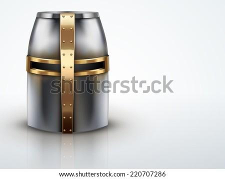 Light Background Crusader Metallic Knight's Helmet with a golden cross. - stock photo