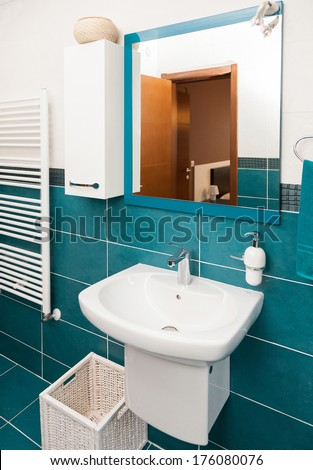 Light bathtub in a bathroom with window.