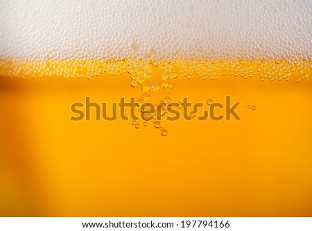 Light beer background close up with foam - stock photo