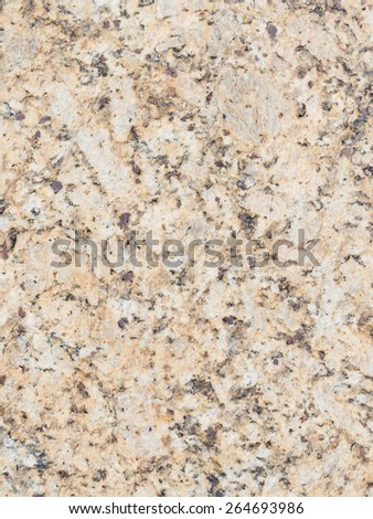 light beige mottled granite stone with brown and gray patches in a large heavy slab