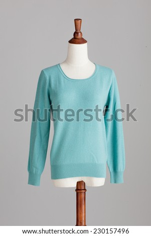 light blue cashmere sweater with wood model on grey isolated - stock photo