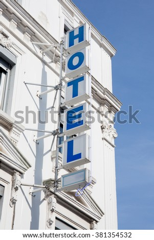 Light blue facade of modern new hotel under blue sky - stock photo