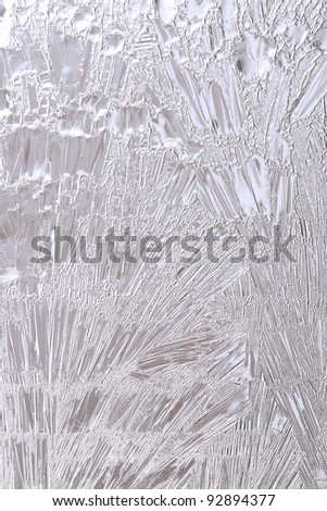 Light blue Ice flower frosting on a window See my portfolio for more - stock photo