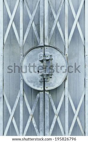 Light blue old metal grille sliding door - stock photo