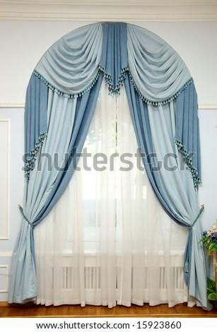 light blue rippled textile curtain - stock photo