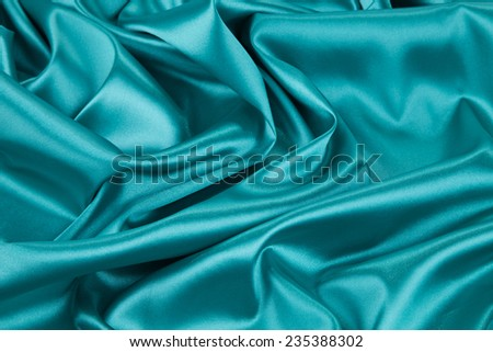 Light blue silk texture cloth texture. Whole background. - stock photo