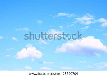 Light blue sky and clouds, may be used as background - stock photo