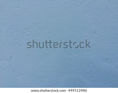 Light blue smooth concrete wall texture background