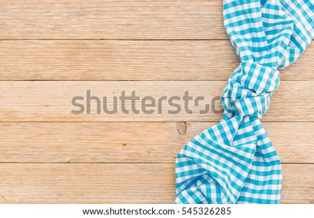 Light Blue Table Cloth On Wood Background.