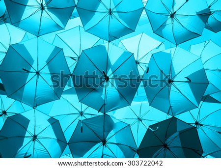light blue umbrellas. color umbrellas urban decoration. - stock photo