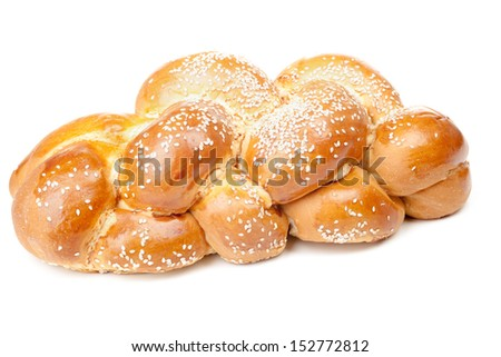 Light braided challah with seeds isolated on white background - stock photo