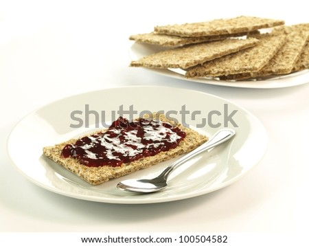 Light breakfast: crispbread with jam on isolated background