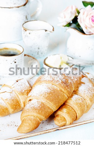 Light breakfast with a cup of coffee, croissants and butter - stock photo
