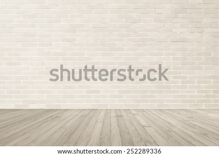 Light brown brick wall textured background with wooden floor in sepia brown tone for interiors: Wooden table or tabletop with brick masonry wall texture - stock photo