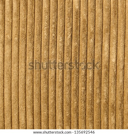 Light brown corduroy fabric close-up. - stock photo
