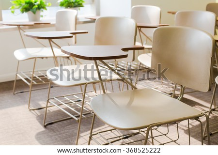 Light Brown Office Chairs in A Clean Classroom of Simple Decoration - stock photo