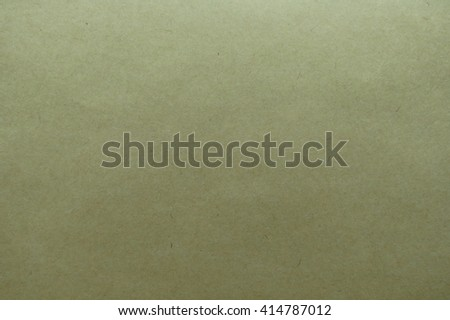 Light brown paper useful as a background - stock photo