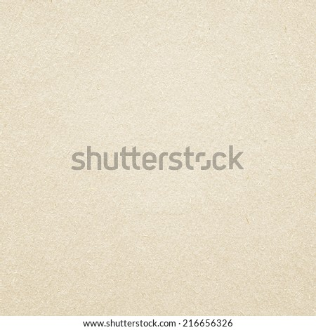 Light brown recycled paper texture made of wooden sawdust. - stock photo