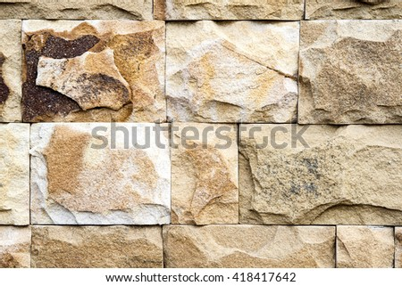 Light Brown Stone wall texture or abstract background. - stock photo