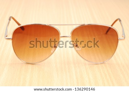light brown sun glasses - stock photo