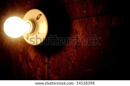 light bulb  against a dark background - stock photo