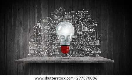 Light bulb and drawing business strategy at background - stock photo