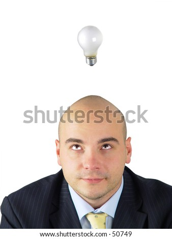 Light bulb hovering over business man's head - stock photo
