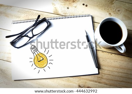 light bulb idea on a sketch book - stock photo