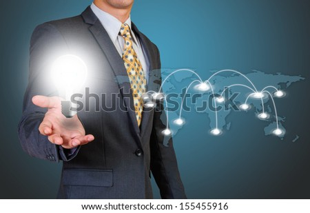 Light bulb  in businessman s hand and global connection  - stock photo