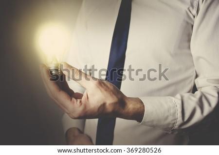 light bulb in hand businessman. - stock photo