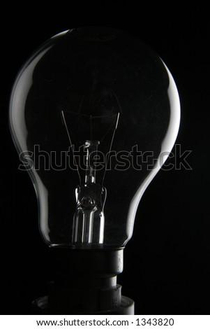 Light bulb in the dark - stock photo