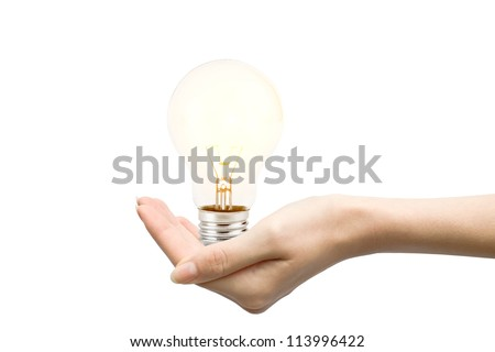 Light bulb in woman hand on white background - stock photo