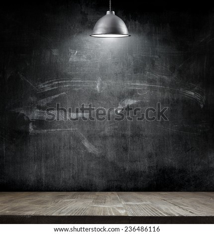 Light bulb lamp on blackboard background with copy space - stock photo