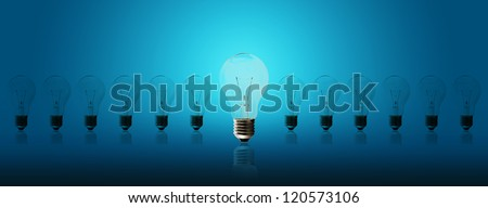 Light bulb lamps on a blue background - stock photo
