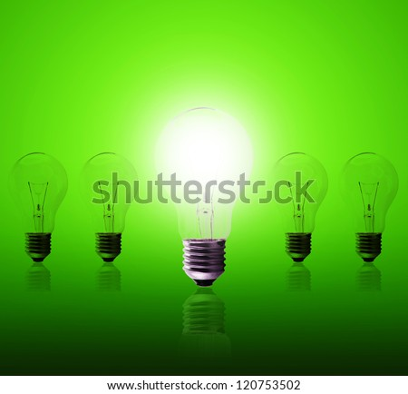 Light bulb lamps on a green background