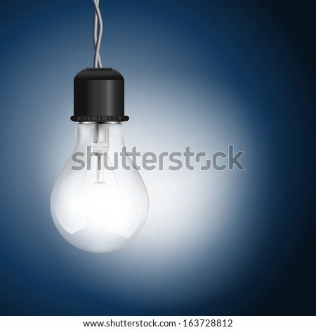 light bulb lighting on blue background