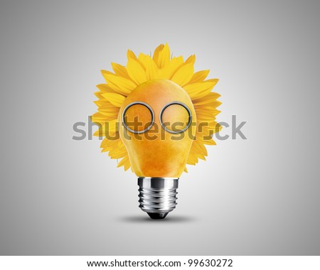 light bulb made from yellow pear and sunflower , light bulb conceptual Image. - stock photo