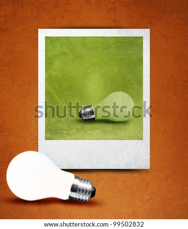light bulb made in and out of photograph  , light bulb conceptual Image. - stock photo