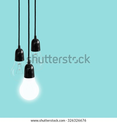Light bulb on blue background, Concept think ideas. - stock photo