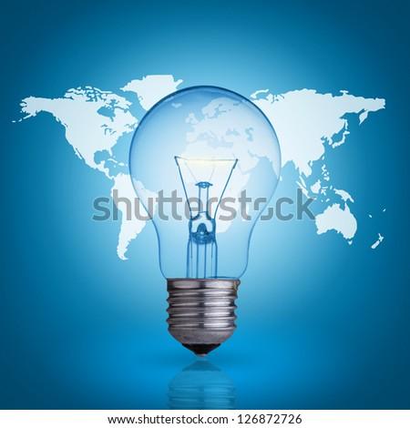 light bulb on blue background world map - stock photo