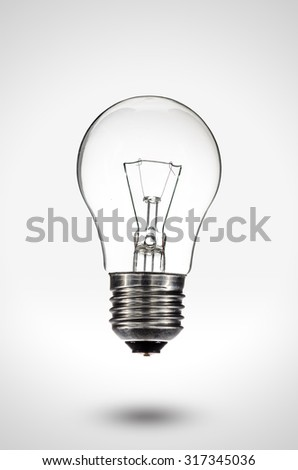 Light bulb on gradient background with shadow and clipping path