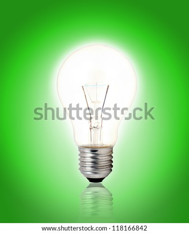 light bulb on Green background. - stock photo