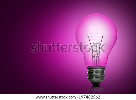light bulb on pink background. - stock photo