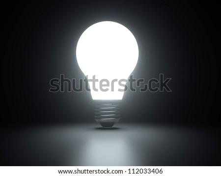 Light bulb shiny rendered on black bakground - stock photo