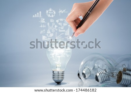 Light bulb with hand drawing graph - stock photo