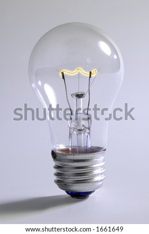 Light bulb with incandescent filament lit