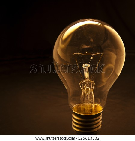 light bulb with low light background use as icon symbol for idea creative & Light Bulb Low Light Background Use Stock Photo (Edit Now)- Shutterstock